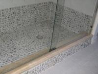 Tan_pebble_tile_in_bathroom