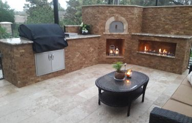 Pizza oven with Noce Split face mosaics and Roman Travertine